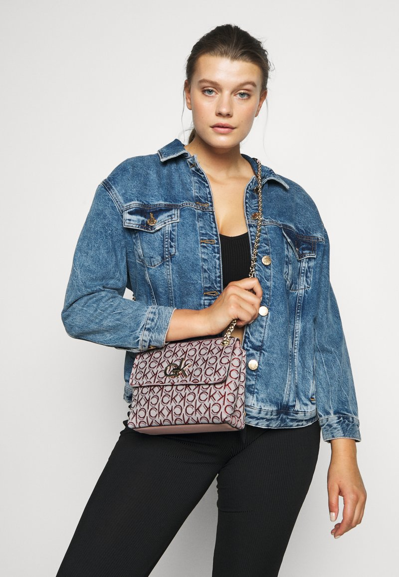 Calvin Klein - RE LOCK CROSSBODY - Across body bag - pink