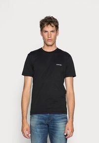 Calvin Klein - CHEST LOGO - Basic T-shirt - black - 0