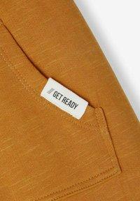 Name it - Pantalon de survêtement - spruce yellow - 2