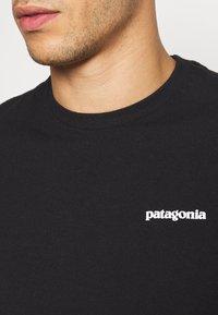 Patagonia - LOGO RESPONSIBILI TEE - Print T-shirt - black - 4