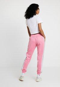 Ellesse - NERVET - Pantalon de survêtement - pink - 2