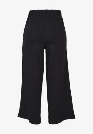 LADIES CULOTTE - Tracksuit bottoms - black