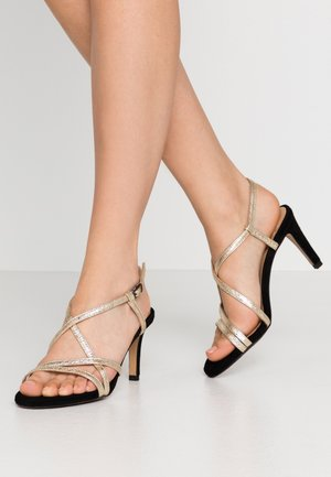 High heeled sandals - or/noir