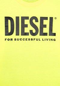 Diesel - TJUSTLOGO ML MAGLIET UNISEX - Top sdlouhým rukávem - super bright yellow - 2