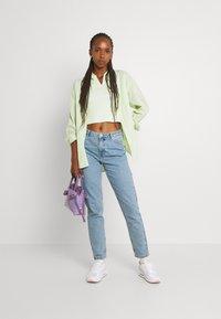 ONLY - ONLJAGGER LIFE HIGH MOM ANKLE - Jeans Tapered Fit - light blue denim - 1
