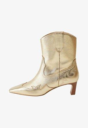 Cowboy/biker ankle boot - goud