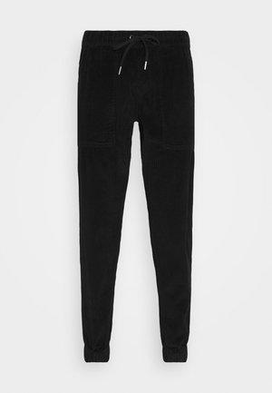 JAZZ PANTS - Trousers - black