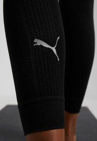 Puma - EVOKNIT SEAMLESS LEGGINGS - Collant - black - 5