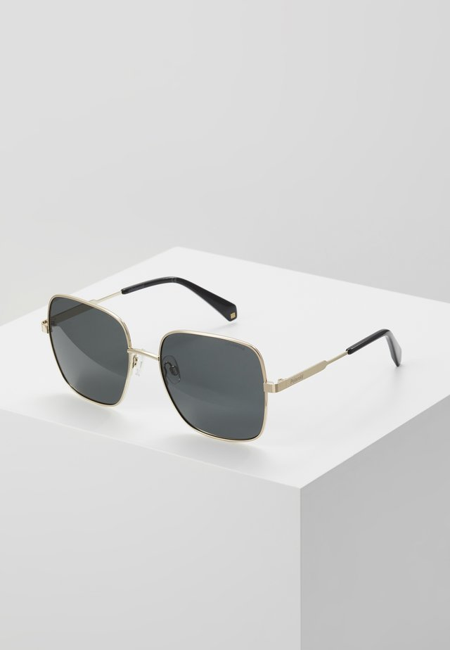 Aurinkolasit - gold-coloured/grey