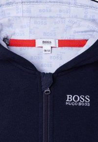 BOSS Kidswear - Zip-up sweatshirt - bleu cargo - 1