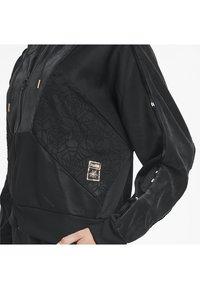 Puma - X CHARLOTTE OLYMPIA  - Training jacket -  black - 4