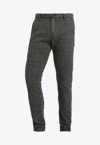 SLIM ARVA HOUNDSTOOTH PANTS - Trousers - grey