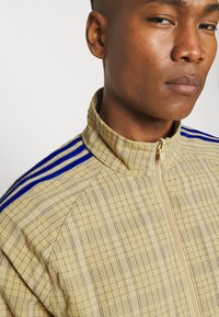 adidas Originals - UNISEX - Summer jacket - hazy beige - 5