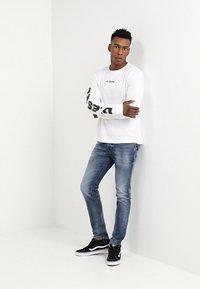 Diesel - THOMMER - Slim fit jeans - 0853p - 1