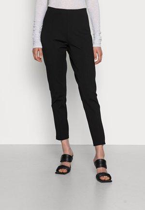 ISSA - Trousers - black