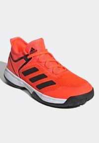 adidas Performance - UBERSONIC 4 K - Multicourt tennis shoes - orange - 1