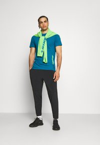 Nike Performance - PANT YOGA - Pantalones deportivos - black/iron grey - 1