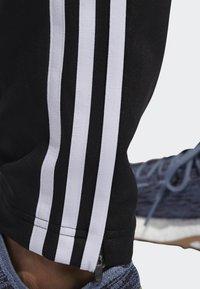 adidas Performance - RUN ASTRO 3-STRIPES TIGHTS - Tracksuit bottoms - black - 4