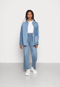 EDITED - ESRA - Straight leg jeans - light blue stone wash - 1