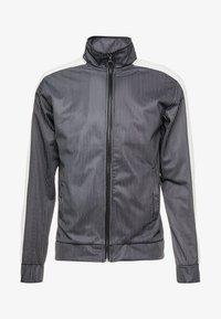 Night Addict - RAIN - Training jacket - black/white - 4