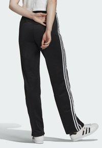 adidas Originals - FIREBIRD TP PB - Pantalon de survêtement - black - 1