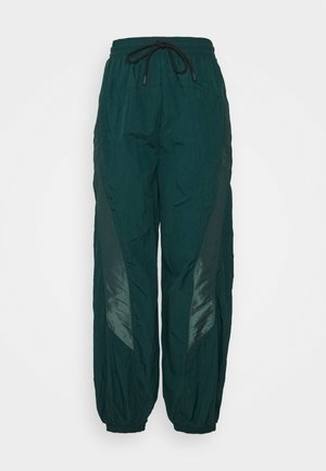 PANT IN - Tracksuit bottoms - forest green