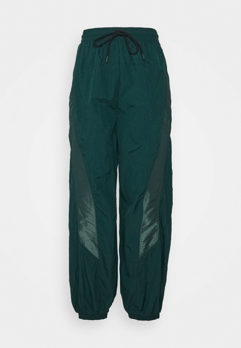 Reebok - PANT IN - Tracksuit bottoms - forest green