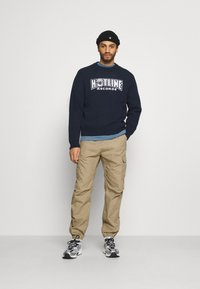 Carhartt WIP - JOGGER COLUMBIA - Cargo trousers - sand - 1