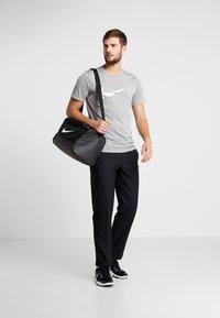 Nike Performance - DRY PANT TEAM - Tracksuit bottoms - black/hematite - 1
