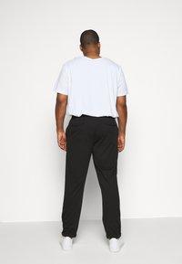 INDICODE JEANS - EBERLEINPLUS - Trousers - black - 2