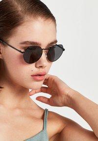 Hawkers - AURA - Sunglasses - black - 1