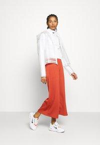 Nike Sportswear - TRANSPARENT - Bomberjacks - white - 1