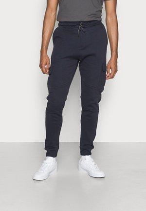 DUSHANE - Cargo trousers - navy