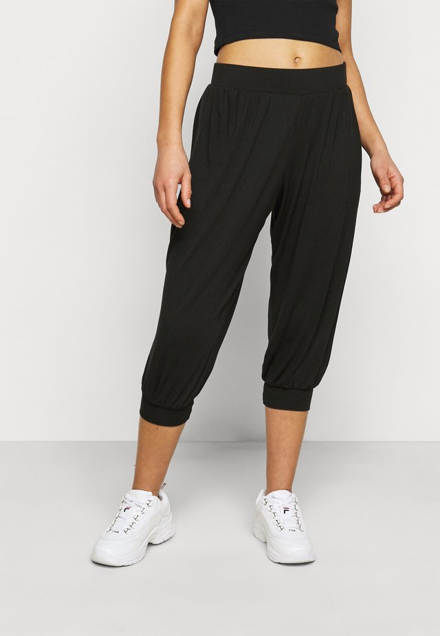 HAREEM - Trousers - black