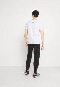 Puma - GRAPHIC TEE - Print T-shirt - white - 2