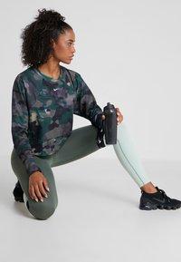 Nike Performance - REBEL ALL IN - Sweatshirt - dark green - 1