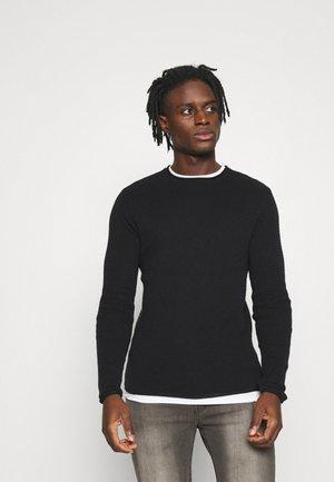 Stickad tröja - jet black/optic white