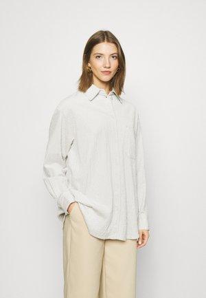 KIRA  - Button-down blouse - beige