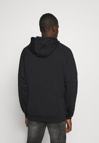 adidas Originals - OUT HOODY - Hoodie - black/white - 2