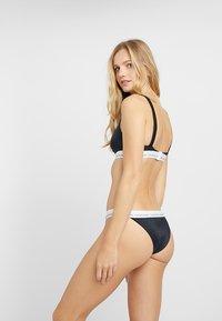 Calvin Klein Swimwear - LOGO CHEEKY - Bikini bottoms - black - 2