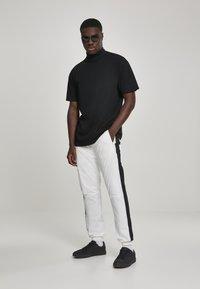 Urban Classics - Tracksuit bottoms - white, black - 1