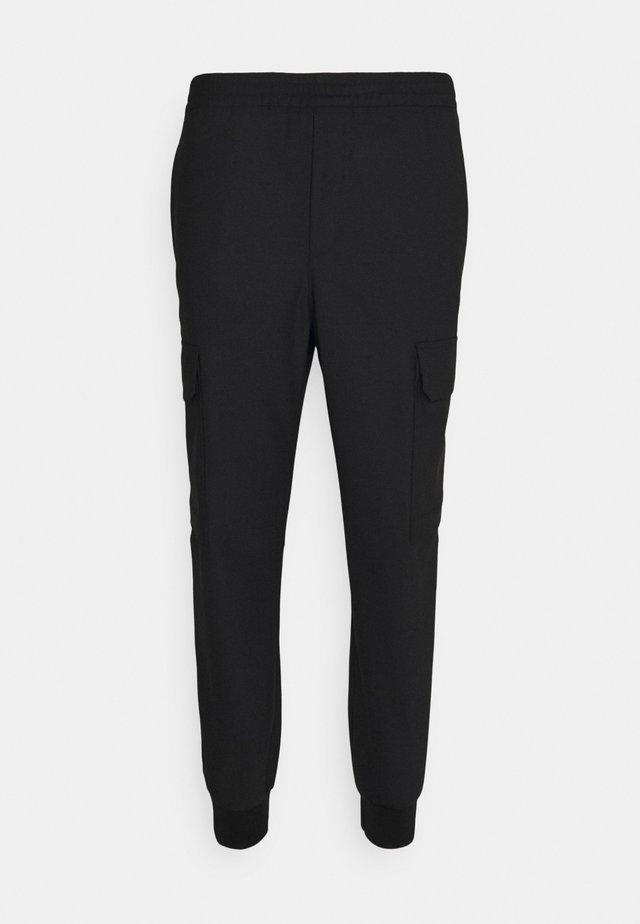 TRAVEL LOOSE CARROT LOW RISE TROUSERS - Cargobroek - black