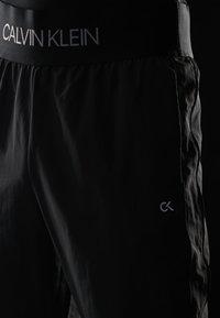 Calvin Klein Performance - TRACK PANTS - Spodnie treningowe - gunmetal/black - 4