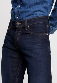 Tommy Jeans - RYAN STRAIGHT - Straight leg jeans - lake raw stretch - 4