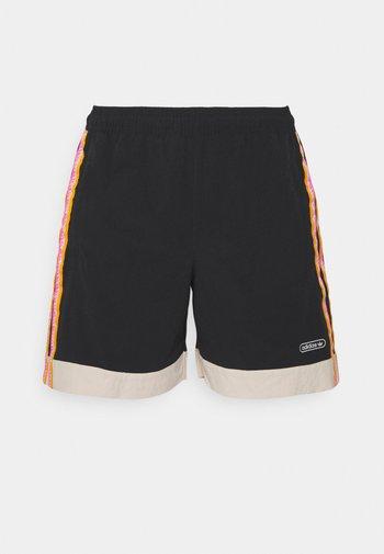 TAPED UNISEX - Shorts - black