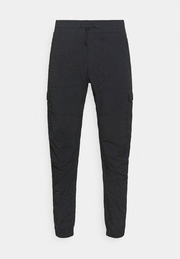 HIT PANT - Trousers - black