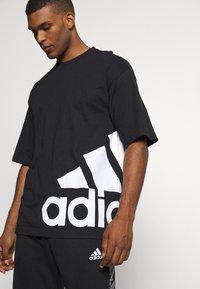 adidas Performance - BOXBOS TEE - Print T-shirt - black/white - 3