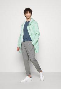 Stutterheim - STOCKHOLM - Waterproof jacket - green mint - 1