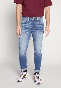 American Eagle - MEDIUM WASH TAPER - Jeans slim fit - medium bright indigo - 0
