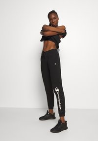 Champion - CUFF PANTS LEGACY - Tracksuit bottoms - black - 1